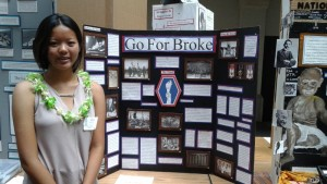 Sixth-grader Victoria (Tori) Yamashita and her panel display on the 442nd RCT, titled 'Go for Broke'.""