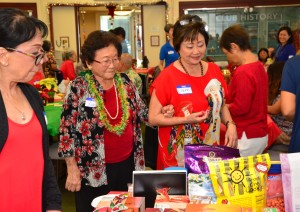 party attendees checking the selection of door prizes