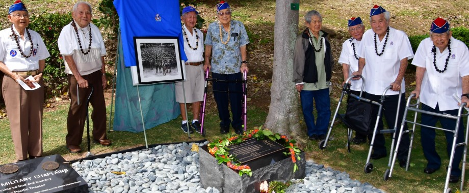 Image of 8 veterans at new memorial monument at Punchbowl