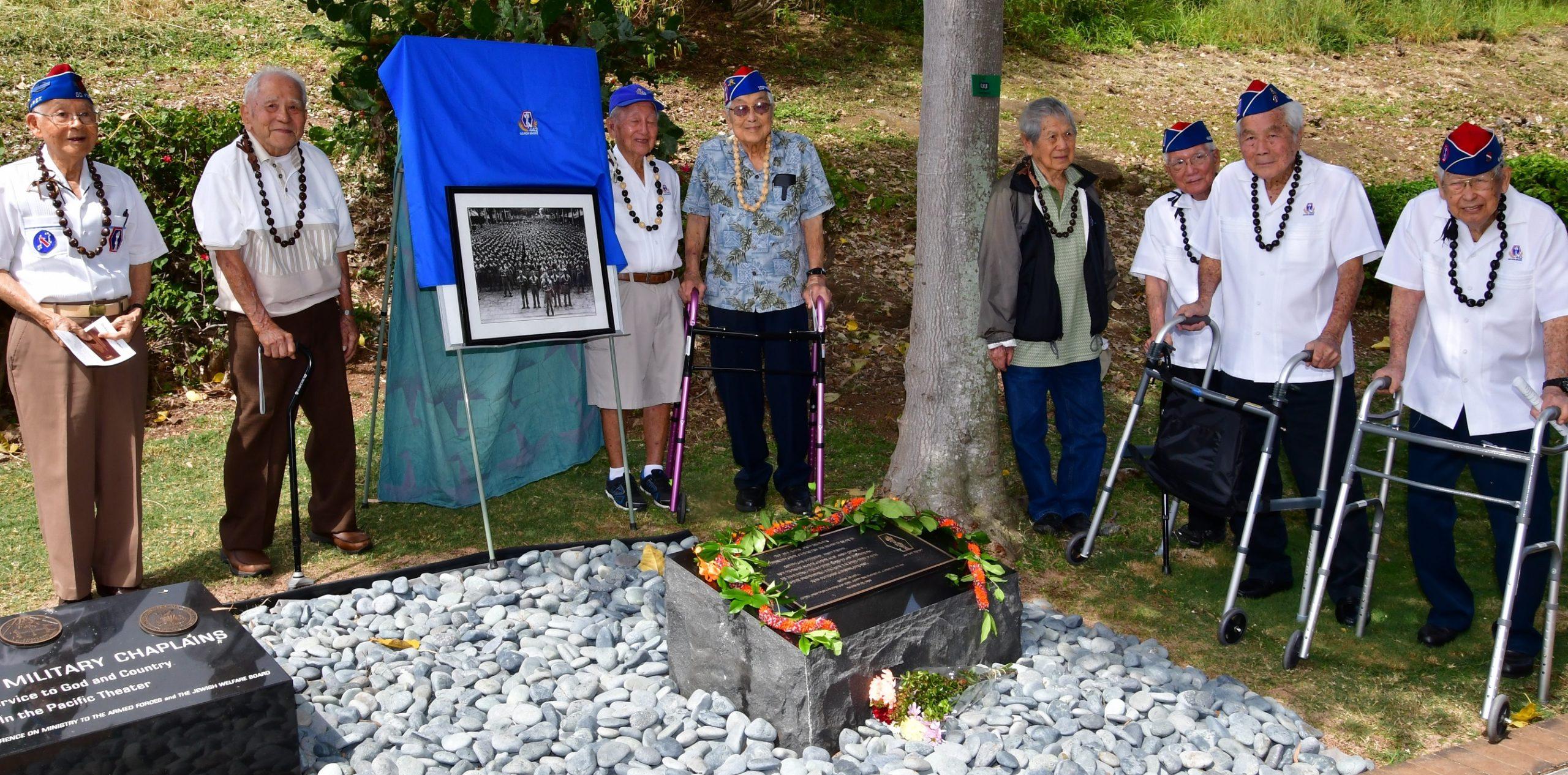 Image of 8 veterans at new memorial monument at Punchbowl
