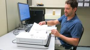 image of Steve scanning documents